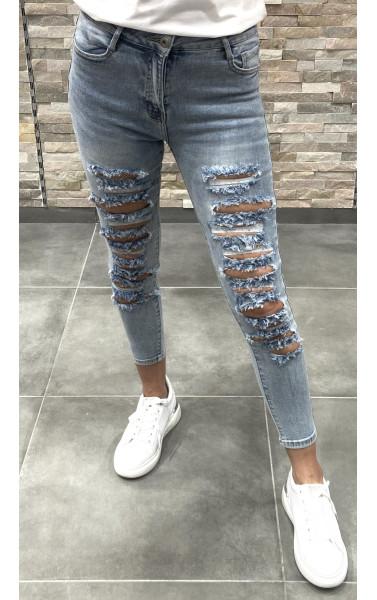 Jeans bleu clair avec déchirure