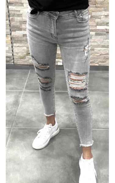 Jeans slim gris clair avec déchirure